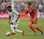 Omar Browne (21) of Panama and Djordje Mihailovic (20) of the United States vie for the ball during their Gold Cup match on June 26, 2019 at Children's Mercy Park in Kansas City, KS.<br /> Tim VIZER/AFP