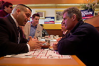 Senator Scott Brown (R-MA) speaks with policeman Robbie Tusino of Milford at a meeting of the Law Enforcement Coalition for Brown at Johnny Jack's Restaurant in Milford, Massachusetts, USA, on Thurs., Nov. 2, 2012. Senator Scott Brown is seeking re-election to the Senate.  His opponent is Elizabeth Warren, a democrat.