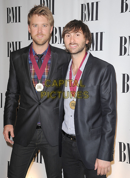CHARLES KELLEY & DAVE HAYWOOD of Lady Antebellum .at The 2011 BMI Pop Music Awards held at The Beverly Wilshire Hotel in Beverly Hills, California, USA, May 17th 2011..half length grey gray suit  medals plaid shirt grey gray .CAP/RKE/DVS.©DVS/RockinExposures/Capital Pictures.