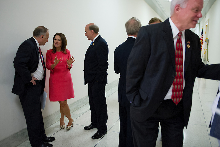 UNITED STATES - May 22 : Rep. Steve King, R-IA., Rep. Michele Bachmann, R-MN., and Rep. Louie Gohmert, R-TX., talk in the hallway of Rayburn House Office Building before the start of a news conference on the Pain Capable Unborn Child Protection Act. (Photo By Douglas Graham/CQ Roll Call)