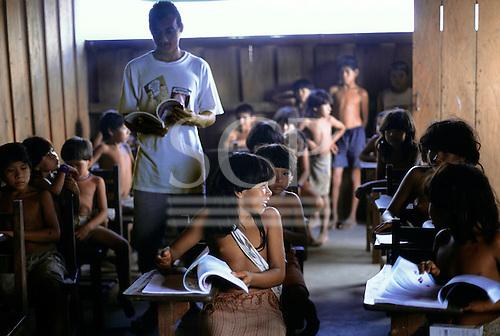 Ipixuna Village, Brazil. Arawete amerindian children in the village school learning Portuguese with teacher. Para State.