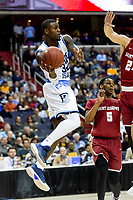 Washington, DC - MAR 10, 2018: Rhode Island Rams guard Jared Terrell (32) makes a jump pass around Saint Joseph's Hawks defenders during their semi final match up of the Atlantic 10 men's basketball championship between Saint Joseph's and Rhode Island at the Capital One Arena in Washington, DC. (Photo by Phil Peters/Media Images International)