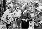 United States President Jimmy Carter, left, and Prime Minister Menachem Begin of Israel, center right, look over some photographs taken during the Camp David Summit as two unidentified aides look on at Camp David, the presidential retreat near Thurmont, Maryland on September 17, 1978. .Credit: White House via CNP