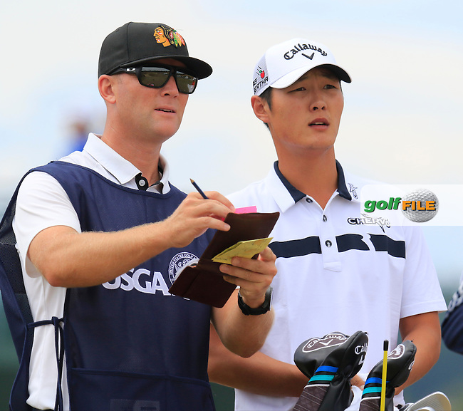 Danny Lee (NZL) and caddy Kurt Kowaluk on the 4th tee during Thursday's Round 1 of the 2015 U.S. Open 115th National Championship held at Chambers Bay, Seattle, Washington, USA. 6/18/2015.<br /> Picture: Golffile | Eoin Clarke<br /> <br /> <br /> <br /> <br /> All photo usage must carry mandatory copyright credit (&copy; Golffile | Eoin Clarke)