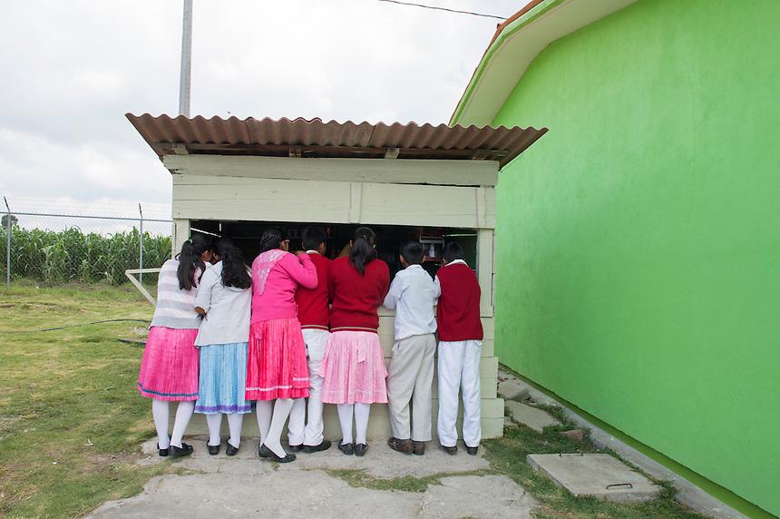 Children buy snacks at their school´s tuk shop. Secondary school Justo Sierra in the  Mazahua indigenous community of San Antonio la Cienega, San Felipe del Progreso, in the Estado de mexico, Mexico