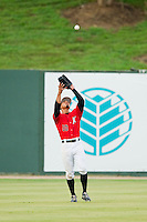 Kannapolis Intimidators center fielder Jacob May (20) settles under a fly ball during the South Atlantic League game against the Delmarva Shorebirds at CMC-Northeast Stadium on August 8, 2013 in Kannapolis, North Carolina.  The Shorebirds defeated the Intimidators 4-3.  (Brian Westerholt/Four Seam Images)
