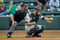 Catcher Devin Mesoraco #36 of the Lynchburg Hillcats frames a pitch as home plate umpire Joey Amaral looks on during a Carolina League game against the Winston-Salem Dash at  BB&T Ballpark May 22, 2010, in Winston-Salem, North Carolina.  Photo by Brian Westerholt / Four Seam Images