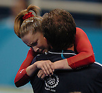 USA Gymnast Carly Patterson cries on her coach, Yevgeny Marchenko' shoulder after seeing her score from the Floor Exercise and realizing that she won the Gold Medal in the Women's Individual All-Around final at the Indoor Hall during the 2004 Summer Olympic Games in Athens,Greece on Thursday, August 19th, 2004..         DENVER POST PHOTO BY STEVE DYKES