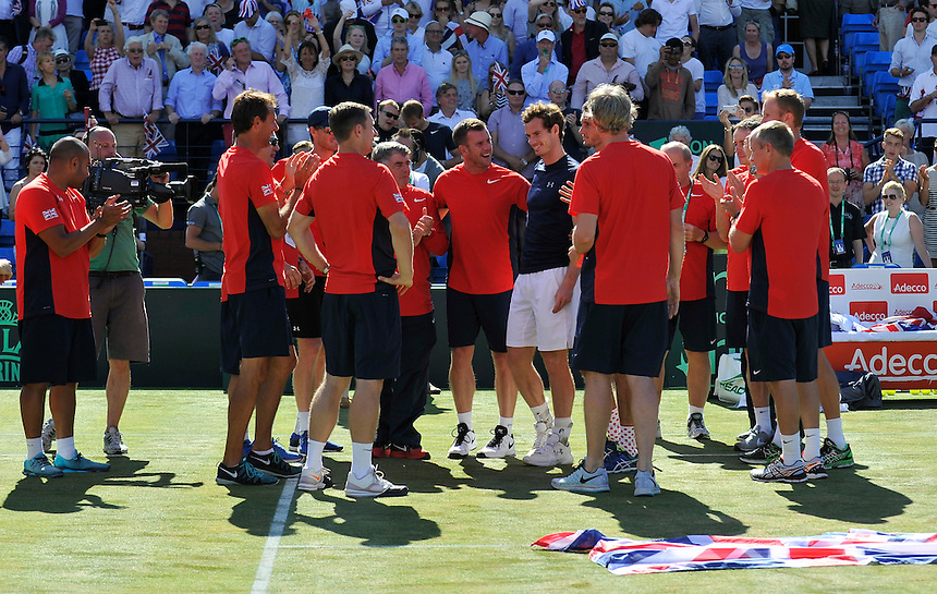 The GB Davis Cup Team celebrating their victory over France as Andy Murray defeats Gilles Simon - Andy MURRAY def Gilles SIMON 4-6, 7-6, 6-3, 6-0<br /> <br /> Photographer Ashley Western/CameraSport<br /> <br /> International Tennis - 2015 Davis Cup by BNP PARIBAS - World Group Quarterfinals - Great Britain v France - Day 3 - Sunday 19th July 2015 - Queens Club - London<br /> <br /> &copy; CameraSport - 43 Linden Ave. Countesthorpe. Leicester. England. LE8 5PG - Tel: +44 (0) 116 277 4147 - admin@camerasport.com - www.camerasport.com.