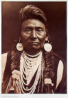 BNPS.co.uk (01202 558833)<br /> Pic: Bloomsbury/BNPS<br /> <br /> Chief Joseph of the Nez Pez in 1903.<br /> <br /> Lost souls - Poignant archive reveals the lost tribes of North America in beautiful photographs from just over a century ago.<br /> <br /> A remarkable collection of photographs which give an unprecedented insight into the lives of Native Americans at a time when their land was being taken from them have emerged at auction.<br /> <br /> Between 1907 and 1930, US photographer Edward Curtis spent time with more than 80 native tribes across Native America, taking thousands of photographs as part of his groundbreaking The North American Indian project.<br /> <br /> A collection of more than 500 rare Curtis photographs are being auctioned off later this month and are expected to fetch over &pound;300,000.