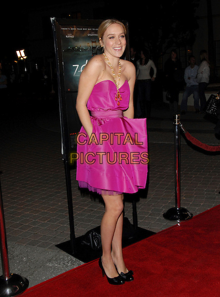 "CHLOE SEVIGNY.The Paramount Pictures L.A Premiere of ""Zodiac"" held at Paramount Studios in Hollywood, California, USA..March 1st, 2007.full length pink dress hands in pockets strapless gold necklace black shoes .CAP/DVS.©Debbie VanStory/Capital Pictures"