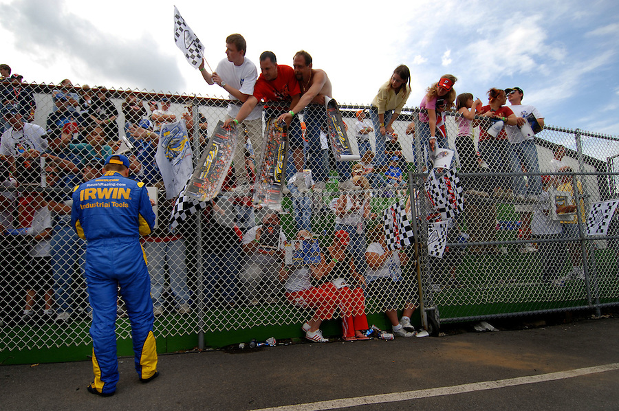 June 9, 2006; Long Pond, PA, USA; Nascar Nextel Cup driver Jamie McMurray (26) signs autographs during qualifying for the Pocono 500 at Pocono Raceway. Mandatory Credit: Mark J. Rebilas
