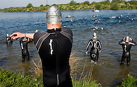 10 MAY 2009 - GRENDON,GBR - A competitor stretches before entering the water - Grendon Triathlon (PHOTO (C) NIGEL FARROW)