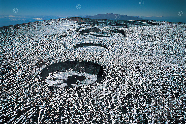 Snow covering calderas of Mauna Loa Volcano, Hawai'i Volcanoes National Park, Big Island.