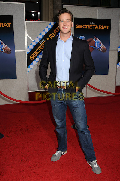 """ARMAND 'ARMIE' HAMMER .""""Secretariat"""" World Premiere held at the El Capitan Theatre, Hollywood, California, USA, .30th September 2010..full length jeans black jacket blue shirt grey gray trainers hands in pockets .CAP/ADM/BP.©Byron Purvis/AdMedia/Capital Pictures."""