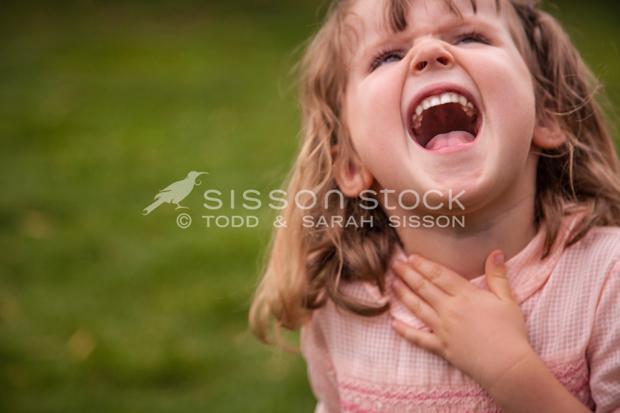 Four year old girl, laughing (close up), New Zealand - stock photo, canvas, fine art print