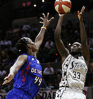 San Antonio's Sophia Young (33) shoots the ball over Detroit's Taj McWilliams-Franklin (44) during Game 2 of the WNBA Championship Finals between the Detroit Shock and the San Antonio Silver Stars, Oct. 3, 2008, at the AT&T Center in San Antonio. Detroit won 69 - 61 to go up 2 - 0 in the five-game series. (Darren Abate/pressphotointl.com)