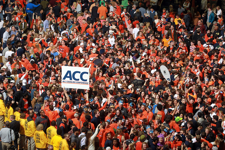 Fans rushed the court after Virginia  defeated Syracuse  75-56 winning the ACC title Saturday March 1, 2014 during an an NCAA basketball game in Charlottesville, VA.