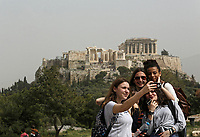 Pictured: A group of youngsters take a selfie against a backdrop of the Acropolis in Athens Greece. Monday 26 March 2018<br /> Re: Strong southern winds from Africa have carried red dust over to Greece.