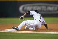 Alcides Escobar (2) of the Charlotte Knights slides into third base during the game against the Rochester Red Wings at BB&T BallPark on May 14, 2019 in Charlotte, North Carolina. The Knights defeated the Red Wings 13-7. (Brian Westerholt/Four Seam Images)