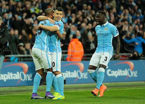 28.02.2016. Wembley Stadium, London, England. Capital One Cup Final. Manchester City versus Liverpool. Manchester City Forward Sergio Agüero and Manchester City Defender Bacary Sagna celebrate with Manchester City Midfielder and scorer Fernandinho after he makes it 1-0 Manchester City