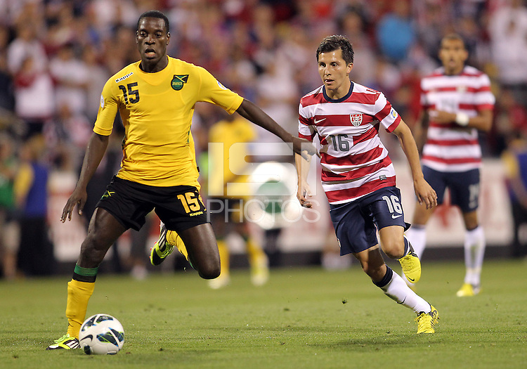 COLUMBUS, OHIO - SEPTEMBER 11, 2012:  Jose Torres (16) of the USA MNT runs up behind JeVaughan Watson (15) of  Jamaica during a CONCACAF 2014 World Cup qualifying  match at Crew Stadium, in Columbus, Ohio on September 11. USA won 1-0.