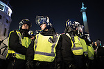 © Joel Goodman - 07973 332324 . 05/11/2016 . London , UK . A large police presence around Trafalgar Square . Supporters of Anonymous , many wearing Guy Fawkes masks , attend the Million Mask March bonfire night demonstration , in central London . Photo credit : Joel Goodman