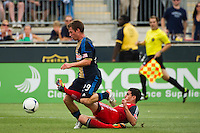Logan Emory (2) of Toronto FC attempts a tackle on Antoine Hoppenot (29) of the Philadelphia Union. The Philadelphia Union defeated Toronto FC 3-0 during a Major League Soccer (MLS) match at PPL Park in Chester, PA, on July 8, 2012.