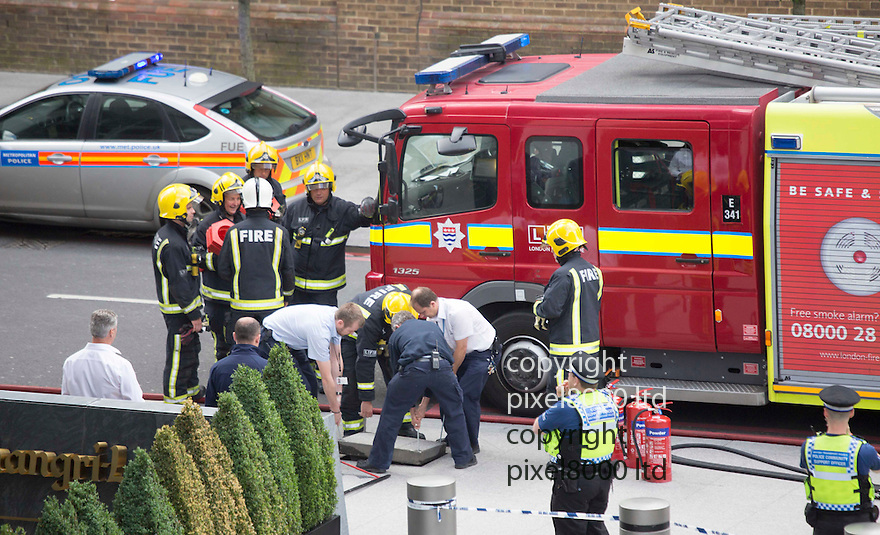 Fire as The Shard building in Central London<br /> <br /> Police and Fire crews at the scene as worried commuters look on.<br /> <br /> Fire suspected in basement<br /> <br /> <br /> <br /> <br /> Pic by Gavin Rodgers/Pixel 8000 Ltd