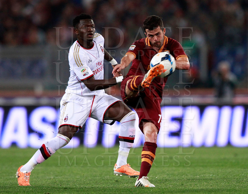 Calcio, Serie A: Roma vs Milan. Roma, stadio Olimpico, 25 aprile 2014.<br /> AS Roma midfielder Miralem Pjanic, of Bosnia, is challenged by AC Milan midfielder Sulley Ali Muntari, of Ghana, left, during the Italian Serie A football match between AS Roma and AC Milan at Rome's Olympic stadium, 25 April 2014.<br /> UPDATE IMAGES PRESS/Isabella Bonotto