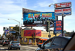 Sunset Strip with Walking Dead billboard over Aahs store at San Vicente Blvd. in Los Angeles, CA