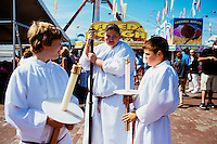 Child acolytes prepare to take part in the Sunday Mass during St. Peter's Fiesta in Gloucester, Massachusetts, USA.