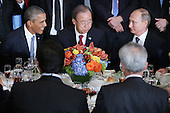 United States President Barack Obama, United Nations Secretary-General Ban Ki-moon and Russian President Vladimir Putin sit together during a luncheon hosted by Ki-moon during the 70th annual UN General Assembly at the UN headquarters September 28, 2015 in New York City. Obama held a bilateral meeting with Indian Prime Minister Narendra Modi and will have a face-to-face meeting with Russian President Vladimir Putin later in the day. <br /> Credit: Chip Somodevilla / Pool via CNP