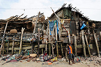 SIERRA LEONE, Tombo, hut of fisherman, food security and the livelyhood of small fishermen are affected by international big trawler fleet / SIERRA LEONE Fischerhafen Tombo, die Ernaehrungssicherung der Kuestenbewohner und die Existenz von Kuestenfischern ist durch Ueberfischung grosser Trawler Flotten bedroht