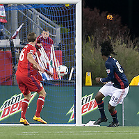 Foxborough, Massachusetts - May 14, 2016: In a Major League Soccer (MLS) match, the New England Revolution (blue/white) defeated Chicago Fire (red), 2-0, at Gillette Stadium.<br /> Femi Hollinger-Janzen scores with header.
