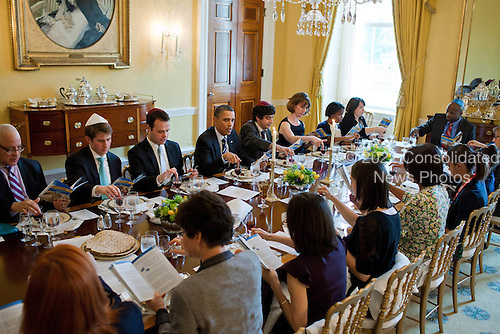 United States President Barack Obama and First Lady Michelle Obama mark the beginning of Passover with a Seder in the Old Family Dining Room of the White House, Monday, April 18, 2011. .Mandatory Credit: Pete Souza - White House via CNP