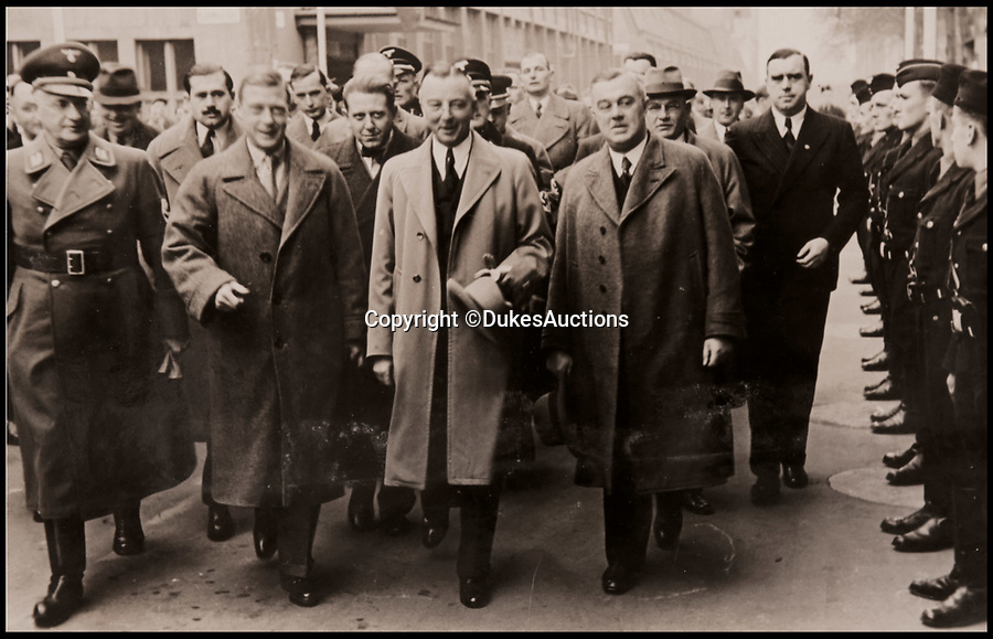 BNPS.co.uk (01202 558833)<br /> Pic: DukesAuctions/BNPS<br /> <br /> Edward, with Daimler chairman Dr Wilhelm Kissel (his left) and Nazi party officials leaving the factory.<br /> <br /> Remarkable photos of Edward VIII touring a car factory during his controversial visit to Nazi Germany in 1937 have been unearthed.<br /> <br /> Huge crowds turned out to catch a glimpse of the former King, rumoured to be a strong supporter of the Nazi party and the fascist cause, who even walked through a guard of Nazi troops giving Hitler salutes.<br /> <br /> The Duke of Windsor, who had abdicated the previous year, was accompanied by high ranking Nazi party officials and even an SS officer whilst touring the Mercedes-Benz factory in Stuttgart.<br /> <br /> During the trip, the Duke had a private meeting with Hitler at his retreat in Berchtesgaden and was infamously photographed giving Nazi salutes.