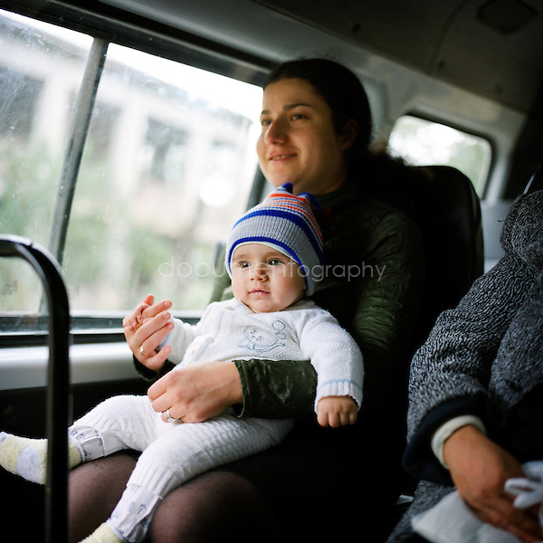A mother and her child in one of the collective buses...Nagorno Karabakh, oct 2010, Shoushi..Magali Corouge/Documentography.