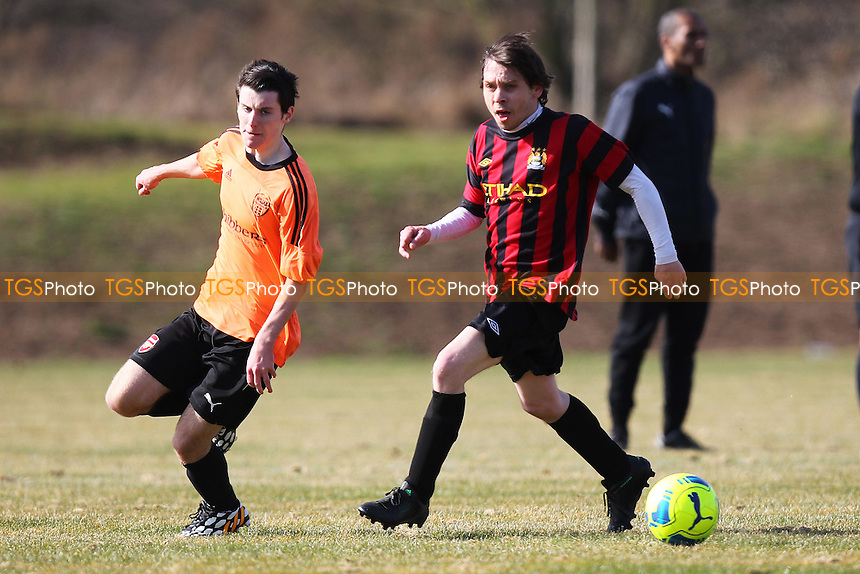 Wojak Sunday (orange) vs Chapel United - Hackney & Leyton Sunday League Junior Cup Semi-Final Football at East Marsh, Hackney Marshes, London - 08/03/15 - MANDATORY CREDIT: Gavin Ellis/TGSPHOTO - Self billing applies where appropriate - 0845 094 6026 - contact@tgsphoto.co.uk - NO UNPAID USE