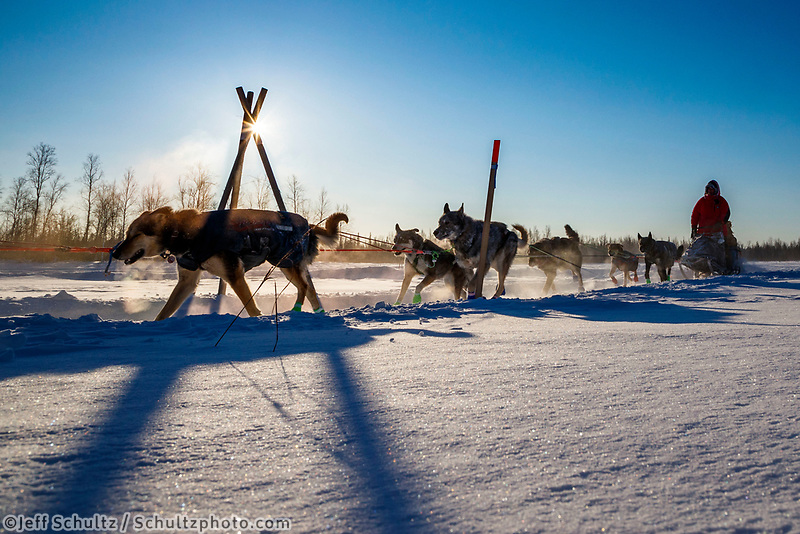 Ryan Redington runs past a tripod trail marker as he leaves the checkpoint in Manley Hot Springs during the 2017 Iditarod on Tuesday March 7, 2017.<br /> <br /> Photo by Jeff Schultz/SchultzPhoto.com  (C) 2017  ALL RIGHTS RESVERVED
