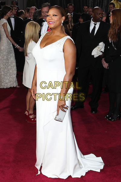 Queen Latifah.85th Annual Academy Awards held at the Dolby Theatre at Hollywood & Highland Center, Hollywood, California, USA..February 24th, 2013.oscars full length white sleeveless dress clutch bag.CAP/ADM/SLP/COL.©Colin/StarlitePics/AdMedia/Capital Pictures