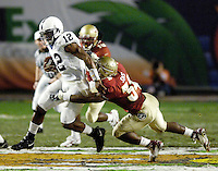 Penn State University Nittany Lion quarterback Michael Robinson rushes for nine yards to the Florida State University 43 yard line in the second quarter of the 2006 Orange Bowl Game.