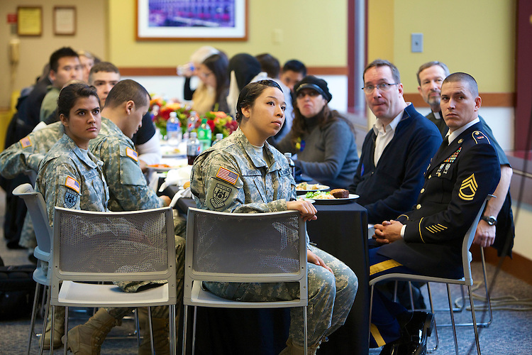 Students, faculty, staff and other attendees listen to remarks at the Veteran's Day Interfaith Service and Luncheon Tuesday, Nov. 11, 2014. The annual event is held in honor of past and present veterans. (DePaul University/Jeff Carrion)