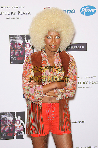 NATALIE COLE<br /> 13th Annual Race to Erase MS - Arrivals held at the Hyatt Regency Century Plaza Hotel, Century City, California, USA, 12 May 2006.<br /> half length blonde afro wig seventies costume arms crossed folded<br /> Ref: ADM/ZL<br /> www.capitalpictures.com<br /> sales@capitalpictures.com<br /> &copy;Zach Lipp/AdMedia/Capital Pictures