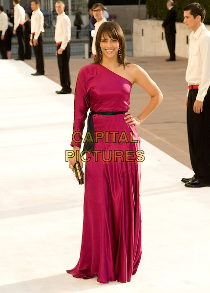 "PAULA PATTON.Opening Night of ""La Fille du Regiment"" at The Metropolitan Opera, Lincoln Center, New York, NY, USA..April 21st, 2008.full length pink one shoulder sleeve dress black belt hand on hip clutch bag.CAP/LNC/TOM.©TOM/LNC/Capital Pictures."