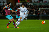 (L-R ) James Tomkins of West Ham United tackles Ki Sung-Yueng of Swansea during the Barclays Premier League match between Swansea City and West Ham United played at the Liberty Stadium, Swansea  on December 20th 2015