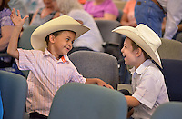 NWA Democrat-Gazette/BEN GOFF &bull; @NWABENGOFF<br /> Sammie White (left), 5, and brother Justin Robinette, 7, play arround on Sunday June 21, 2015 before service at Corner Post Cowboy Church East of Siloam Springs.