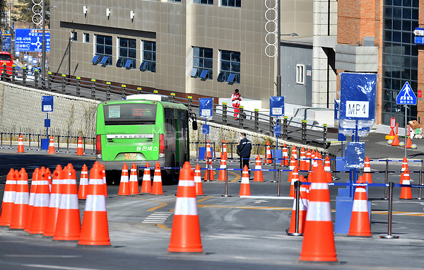 A buss passing a security check in front of the Cultural Centre in Gangneung, South Korea, 07 February 2018. The Pyeongchang 2018 Winter Olympics take place between 09 and 25 February. Photo: Peter Kneffel/dpa /MediaPunch ***FOR USA ONLY***