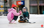 NAUGATUCK, CT- 25 FEB 06- 022507JT04- <br /> Ariana LoCascio, 7, and Brian Parzyck, 5, inspect of a peice of ice which they concluded resembled a pig's ear at the ice skating rink on the Naugatuck Green on Sunday afternoon.<br /> Josalee Thrift Republican-American