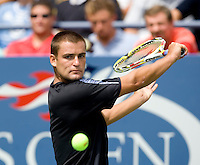 Mikhail Youzhny (RUS) beat Paul-Henri Mathieu (FRA) (26) in the first round. Youzhny beat Mathieu 2-6 7-5 6-0 6-2..International Tennis - US Open - Day 1 Mon 31 Aug 2009 - USTA Billie Jean King National Tennis Center - Flushing - New York - USA ..Frey,  Advantage Media Network, Barry House, 20-22 Worple Road, London, SW19 4DH